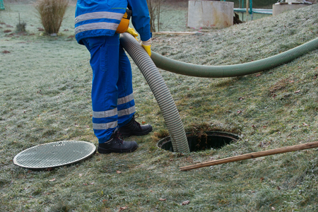 Emptying household septic tank. Cleaning sludge from septic system. Stok Fotoğraf - 85682868