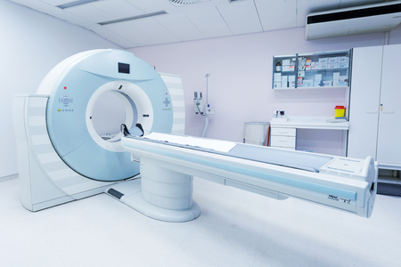 CT - Computerized Tomography Scan Device in Hospital. Medical Equipment and Health Care. Stock Photo