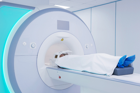 Female patient undergoing MRI - Magnetic resonance imaging in Hospital. Medical Equipment and Health Care.  Zdjęcie Seryjne