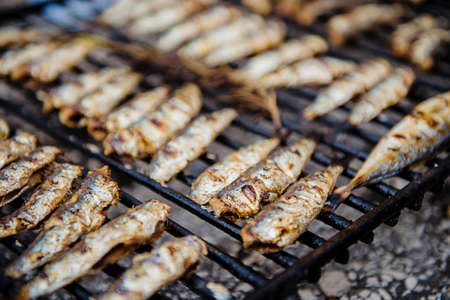 Fresh grilled sardines on grill. Close up, shallow depth of filed. 스톡 콘텐츠