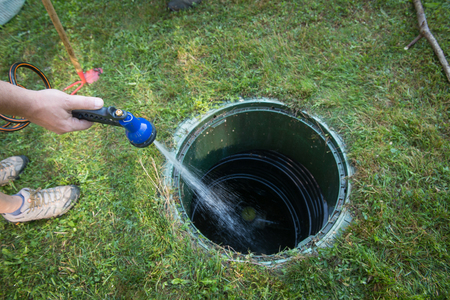 Cleaning and unblocking septic system and draining pipes. 스톡 콘텐츠