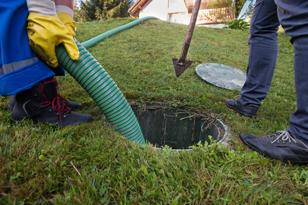 Emptying household septic tank. Cleaning and unblocking clogged drain. Stock Photo