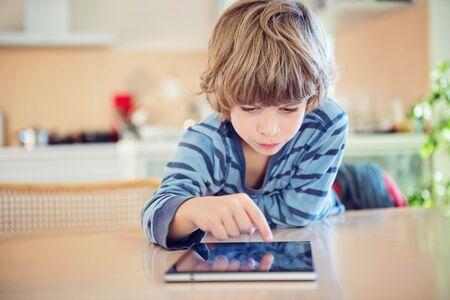 Little boy using digital tablet. Reklamní fotografie