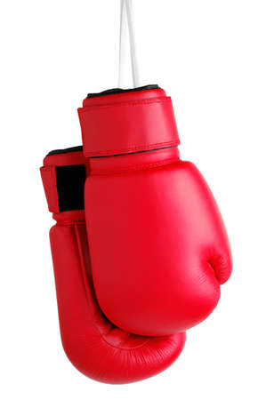 Boxing Gloves hanging by their laces against a white background