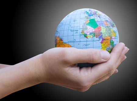 Human Hand Holding the World in Her Hands Stock Photo - 5788351