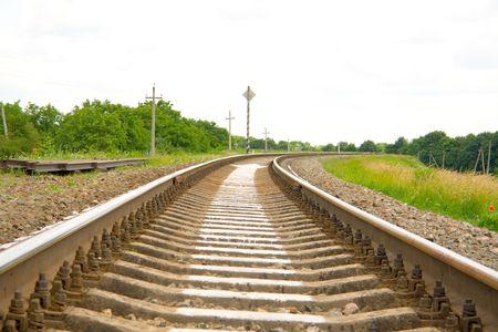onward: Railway track leading far onward Stock Photo