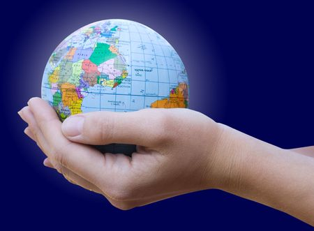 Human Hand Holding the World in Her Hands  Stock Photo - 6030340