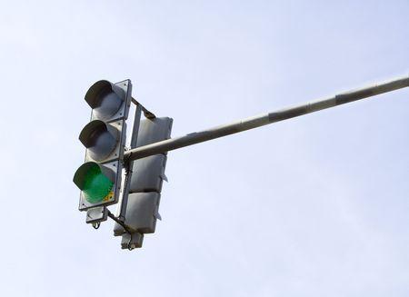 Traffic-light on sky background photo