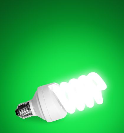 kilowatt: white economical  bulb on the white backgrounds Stock Photo