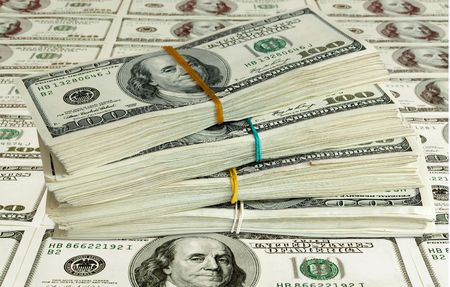 american currency: big pile of money. stack of american dollars Stock Photo