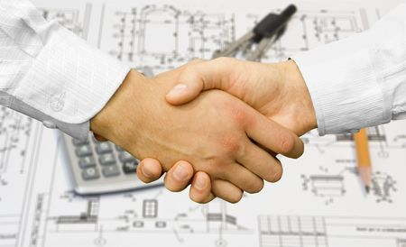 projekt:  Businessman teamwork partners shaking hands