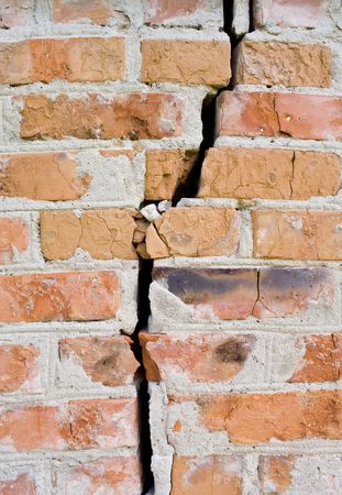split level: red broken wall at earthquake Stock Photo