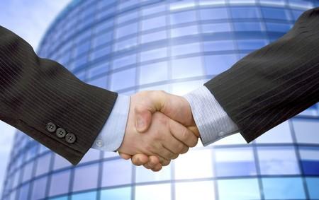 Businessman teamwork partners shaking hands photo