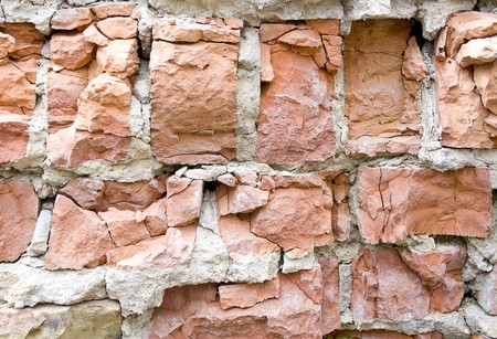 red broken wall at earthquake photo