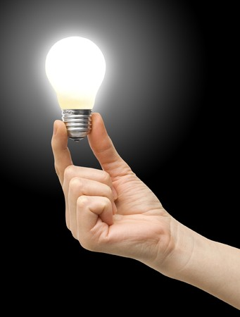 bulb in a hand on a background Stock Photo - 7318493
