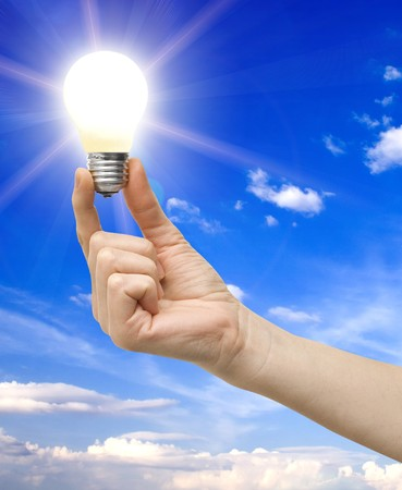 invent: bulb in a hand on a background