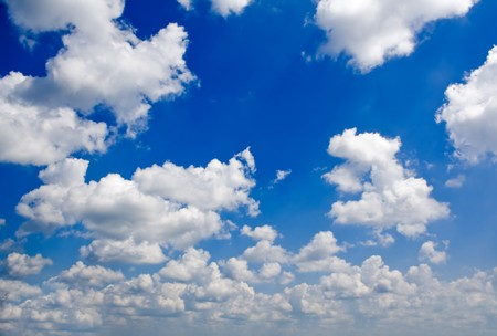 blue ray: nature background. white clouds over blue sky