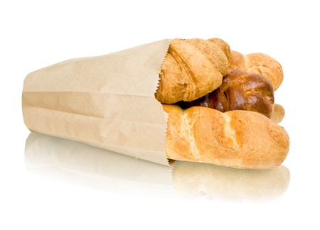 fresh baked rolls in a basket on white photo