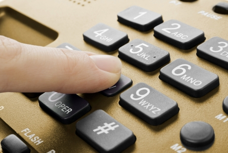 phone number: office black telephone with hand isolated on white Stock Photo