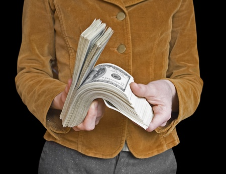 money in a businessman hand on the white photo