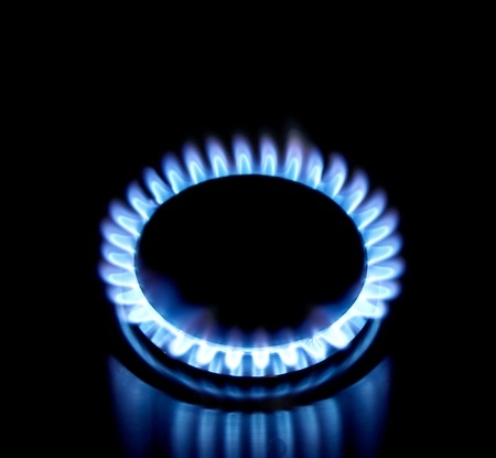 burner: Blue gas stove in the dark