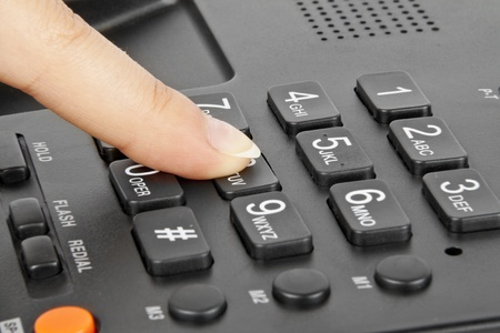 telephone receiver: office black telephone with hand isolated on white Stock Photo