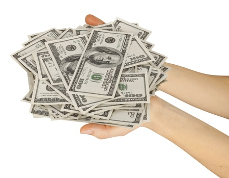 Many dollars falling on womans hand with dollars  photo