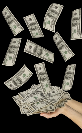 Many dollars falling on womans hand with money Stock Photo - 11724821