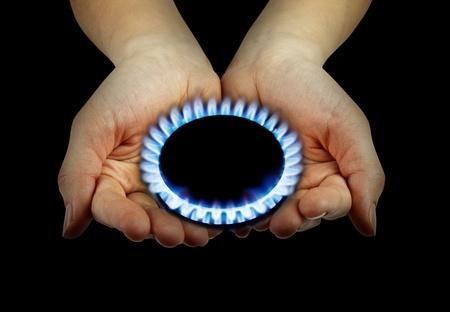 burner: blue gas in hands on the black