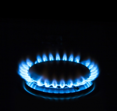 gas stove: Blue gas stove in the dark