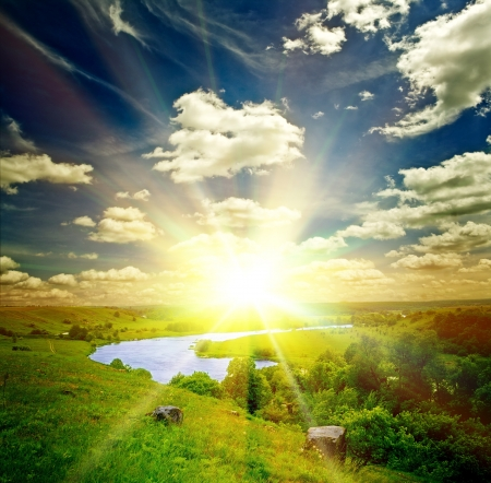 river trunk: beautiful sunny landscape with field and forest Stock Photo