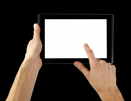 tablet computer isolated in a hand on the white backgrounds photo