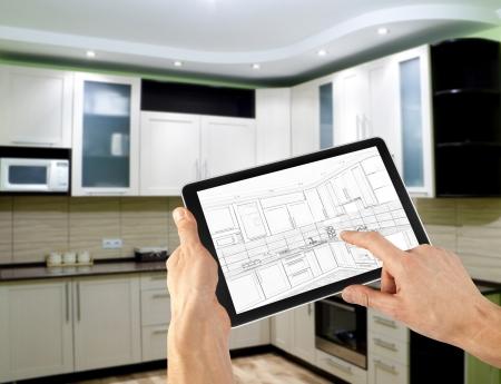 タブレット コンピューターでインテリア レイアウト計画。ビジネス。キッチン