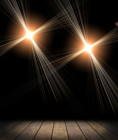 Spot lighting over dark background and wood floor. concert photo