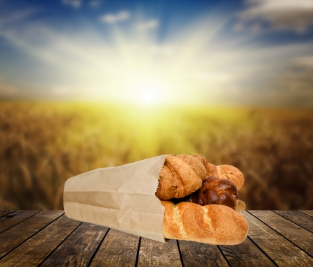 bread on the wood textured backgrounds in a room interior on the sky field  backgrounds photo