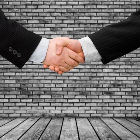 busines man handshake with modern interior background  photo