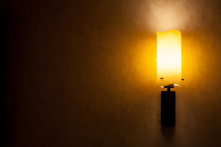 dark room: glowing lantern on a wall for advertising Stock Photo