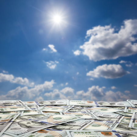 cloude: big pile of money. stack of american dollars on the sky backgrounds  Stock Photo