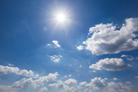 weather forecast: nature background. white clouds over blue sky