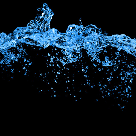fluidity: Blue water and air bubbles in the pool over black background with space for text