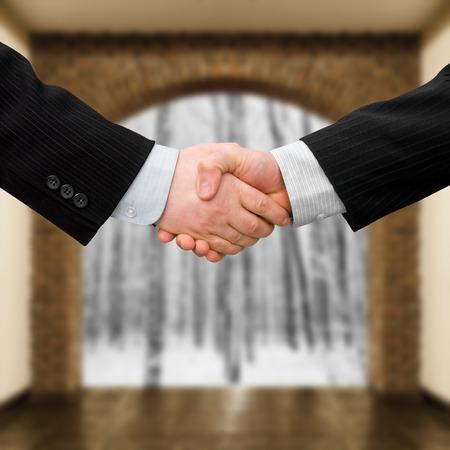 business men handshake with modern interior background photo