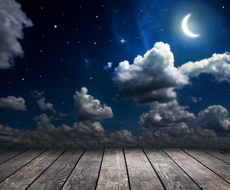 over the moon: night sky with stars, moon and clouds Stock Photo