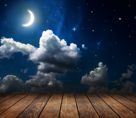 moon surface: night sky with stars and moon and clouds Stock Photo