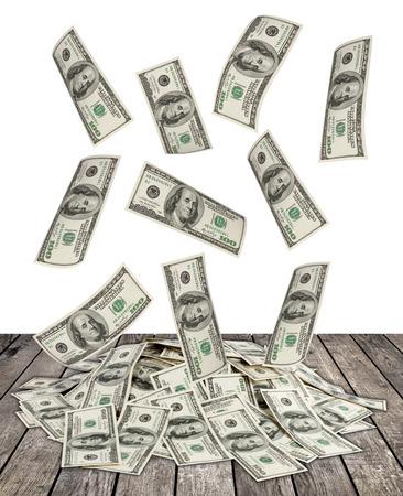money pile: big pile of money. dollars over white wood background Stock Photo