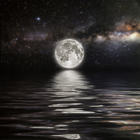 horizon over water: month on a background star sky reflected in the sea. Elements of this image furnished by NASA