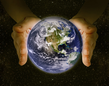 earth hands: man holding the planet earth in the hands against the background of the galaxy. Elements of this image furnished by NASA