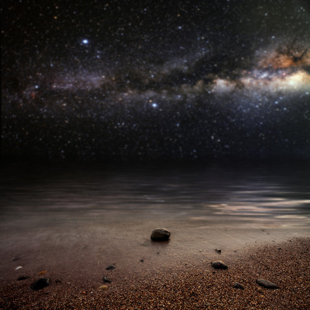 month on a background star sky reflected in the sea. Elements of this image furnished by NASA photo