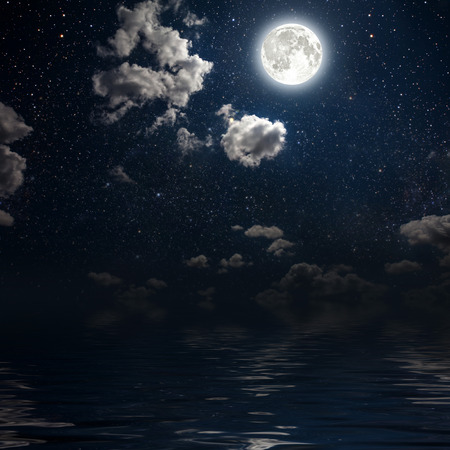 blue stars: moon on a background star sky reflected in the sea. Elements of this image furnished by NASA