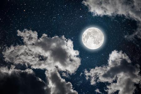 星と月と雲と背景の夜空。木材。NASA から提供されたこのイメージの要素 写真素材