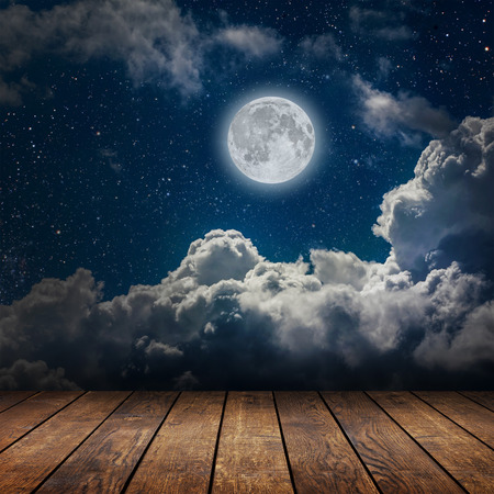 night table: backgrounds night sky with stars and moon and clouds. wood. Elements of this image furnished by NASA